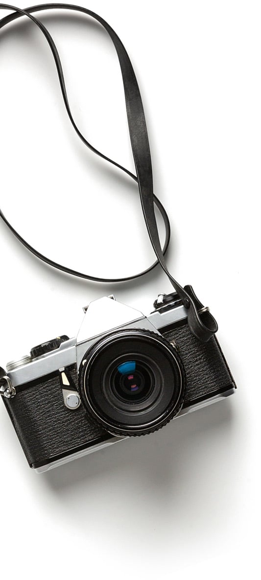 camera with strap on white background
