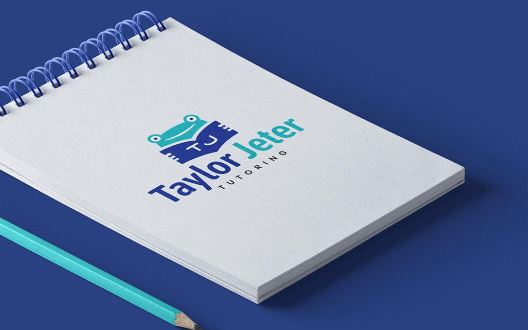 tutoring logo on notepad with blue background