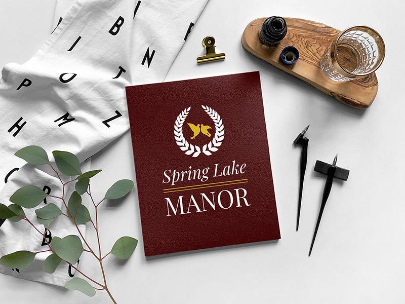 Spring Lake Manor logo design in reversed coloring